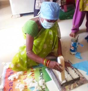 A woman producing sanitary napkins